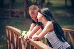 Love and affection between a young couple. At the park stock photos