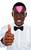 Love african boy gesturing thumbs-up Royalty Free Stock Photos