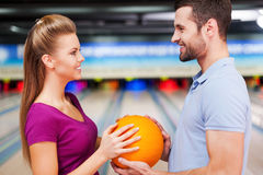 In love against the background of bowling alleys. Stock Photos