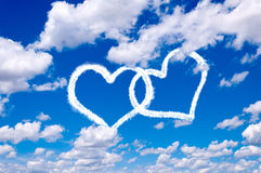 Love in the air. Concept with heart shape clouds Royalty Free Stock Photos