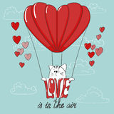 Love is in the air. Cute cartoon cat and the air balloon Royalty Free Stock Photography