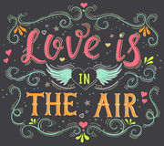 Love is in the air. Hand drawn typography poster. Royalty Free Stock Photography
