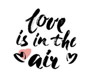 Love is in the air hand lettering. Hand drawn card design. Brush Lettering Design. Vector illustration Royalty Free Stock Photos
