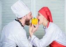 Love is in the air. happy couple in love with healthy food. Family cooking in kitchen. vegetarian. cook uniform. Dieting stock photo