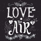 Phrase and elements about love. Love is in the air. Inspirational lettering quote. Hand drawn vintage design. Font with ornamental elements, and decor. White on Stock Photos
