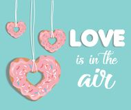 Love is in the air. Vector illustration with donuts. Greeting card with St. Valentine`s Day Stock Photography