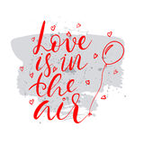 Love is in the air text.Card with calligraphy Royalty Free Stock Images