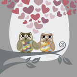 Love is in the air for two owls. This image is a vector illustration. Please visit my portfolio for more similar illustrations Royalty Free Stock Photography