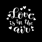 Love is in the air. Vector lettering. Decorative phrase about love for Valentines Day card or holiday design Royalty Free Stock Photos