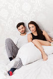 Love is in the air. Young couple snuggling in bed Stock Photography