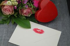 Love is all around. A loveletter from your valentine, red roses and the wedding ring as an external sign of inner connectedness Stock Image