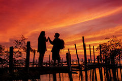 Love is all around. Sunset at the lake with red sky background Stock Photo