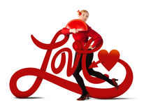 Love is all around. A young blonde woman holding a red fan behind the word love Stock Images