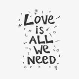 Love is all we need. Hand drawn lettering in black-white style with ornament of hearts and flowers vector illustration