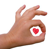 Love All right. Hand gesture OK with a red heart inside Stock Photo
