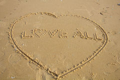Love All. Love written in sand at beach Royalty Free Stock Photos
