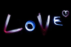 LOVE alphabet by light over black background Royalty Free Stock Images