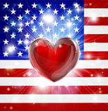 Love America flag heart background. Flag of America patriotic background with pyrotechnic or light burst and love heart in the centre Royalty Free Stock Photography
