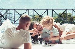 Free Love And Trust As Family Values. Love Concept Of Family Play Chess With Little Boy On Sunny Balcony. Royalty Free Stock Photos - 143159828