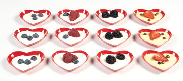 Love aperitif. Fruit dessert on a heart red plate Royalty Free Stock Photos