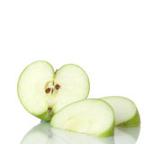 Love apple (Heart Shape). Heart-shape sliced green apple with cut segments on a reflective surface against a white background. Copy space royalty free stock photos