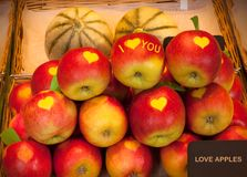 Love apples for sale. Heart shape on the apples stock images