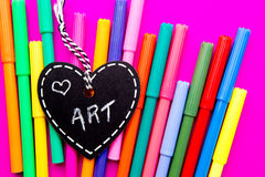 Love Art - colored pens on pink background. Love Art - multi colored pens on pink background Royalty Free Stock Images