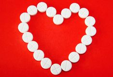 Love as the drug. White pills form heart shape in concept image of love as the drug Royalty Free Stock Photo