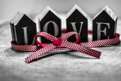 Love as a gift. Black and white photo with a focus on red color as a symbol of love. Valentine`s day greeting card with place for text royalty free stock images