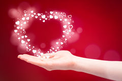 Love as a Gift - Heart in a Hand Royalty Free Stock Image