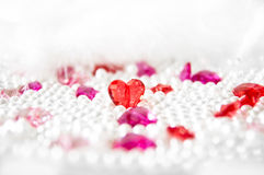 Love background 2. Glassy hearts with pearl-like balls Royalty Free Stock Image