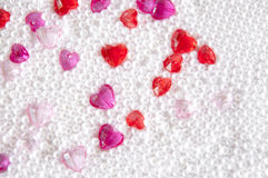 Love background. Glassy hearts with pearl-lika balls Stock Images