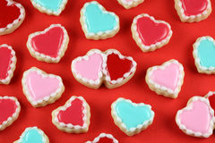 Love Background. Heart cookies on a red background royalty free stock photo