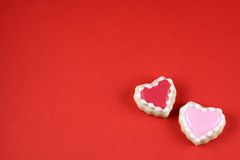 Love Background. Heart cookies on a red background stock photos