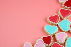 Love Background. Heart cookies on a teal background stock photo