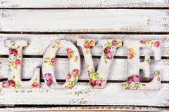 Love background with decoupage decorated letters with rose patte Stock Photos