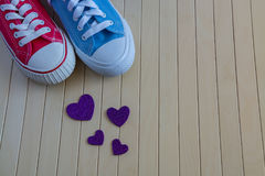 Love background with different sneakers and purple hearts Royalty Free Stock Photo
