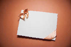 Love background with drapery. White postcard with beige bow for text Royalty Free Stock Photography