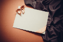 Love background with drapery. White postcard with beige bow for text Royalty Free Stock Photos