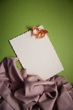 Love background with drapery. White postcard with beige bow for text Stock Photos
