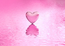 Love background heart on water. Isolated pink heart above a reflective sea. Metaphor for reflection of love, self, touching, emotion and innermost feeling Royalty Free Stock Photo