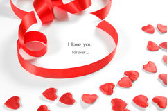 Love background. Small hearts and ribbon Stock Photo