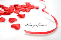 Love background. Small hearts and ribbon Royalty Free Stock Image