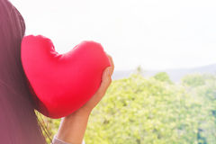Love background women with red heart on nature and sweet colour Royalty Free Stock Photo