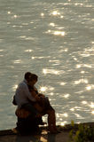 Love in backlight. Two lovers in a romantic sunset Stock Photo