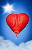 Love balloon. Balloon in the form of heart soars in the sky Royalty Free Stock Photo