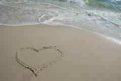 Love on beach. Heart shape in sand on a beach in Florida Stock Photos