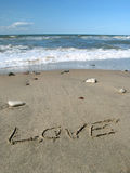 Love on the beach. Word love written on the sand Royalty Free Stock Images