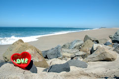 Love at the beach 2. Red hart in the sand at the beach royalty free stock image