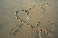 Love on the Beach. Big heart drawn in the sand on the beach Royalty Free Stock Image